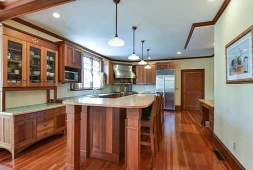 Big kitchen island, 2 dishwashers, 2 sinks & desk.