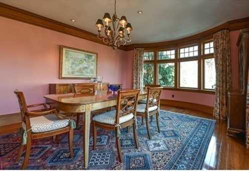 Banquet size dining room & oversized living room w/ built-in benches & fireplace