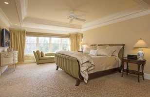 The master features walk-in closets, a sitting room w/fireplace, gym.