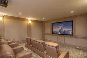 Lower level includes a state of the art screening room, game room & music room. Mins to city & airport.