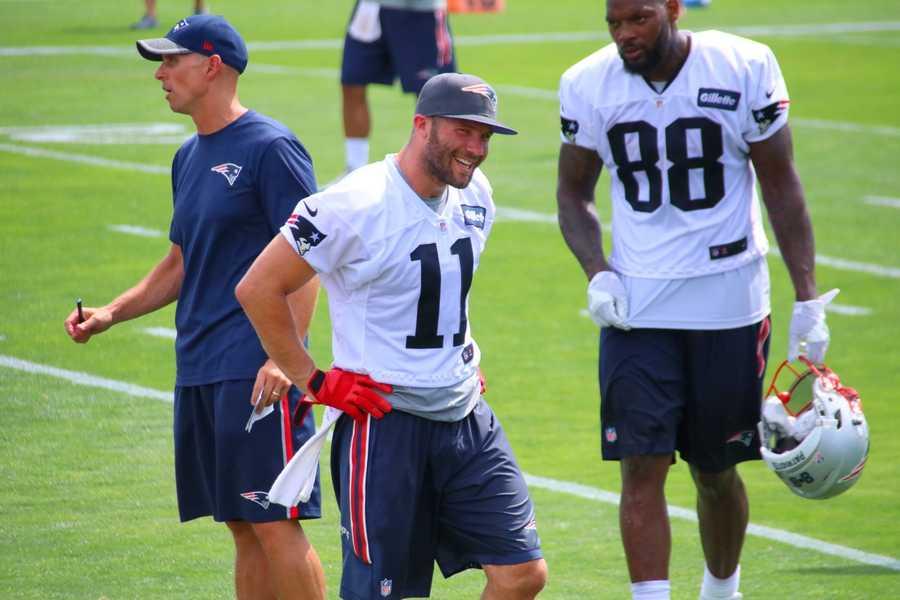 Patriots wide receiver Julian Edelman smiles as he hears a remark from the fans in the crowd. Edelman is also being held out of practice as he recovers from off-season surgery.