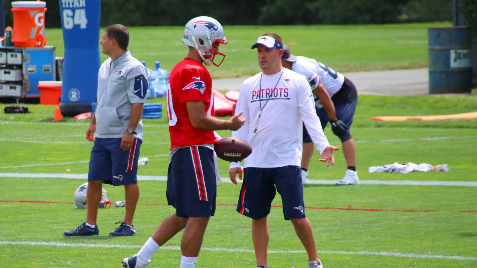 Offensive coordinator Josh McDaniels speaks with quarterback Jimmy Garoppolo after day 1 of Patriots training camp.