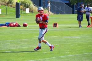 Patriots quarterback Tom Brady tosses a pass in training camp drills.
