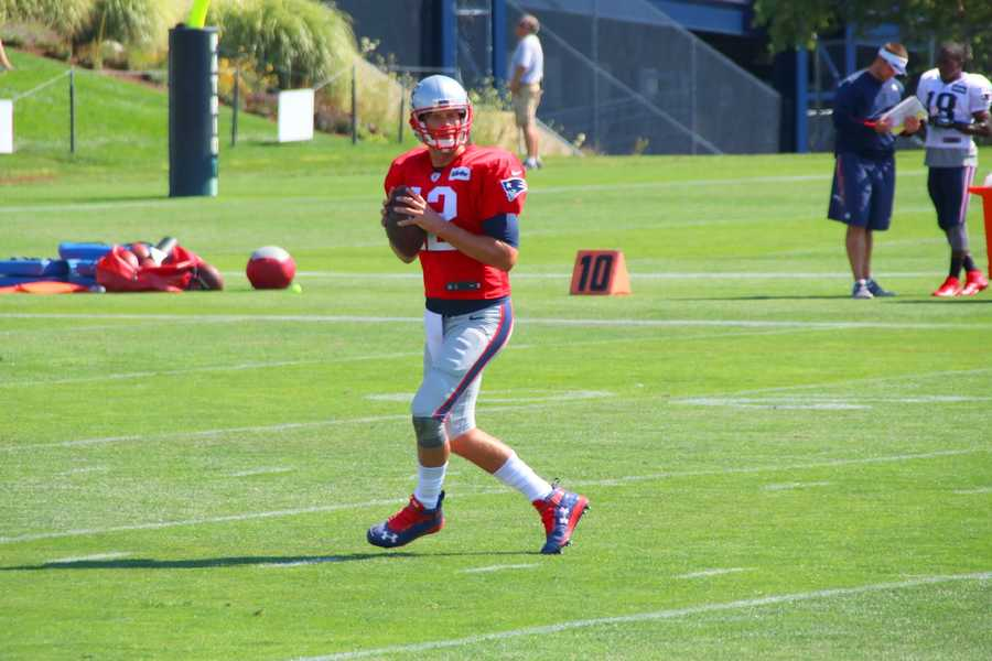 Patriots quarterback Tom Brady tosses a pass in training camp drills.
