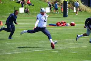 Patriots kicker Stephen Gostkowski kicks off during training camp on Saturday.