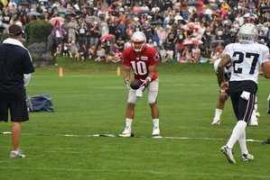 Patriots quarterback Jimmy Garoppolo takes snaps during the team's practice on Sunday, July 31.