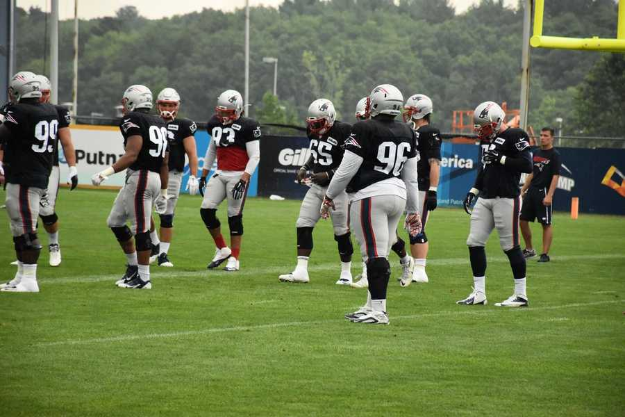 Patriots defensive players work out during day 4 of training camp at Gillette Stadium in Foxborough.