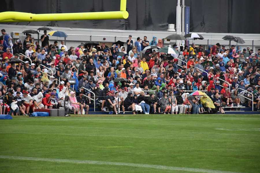 Wet and cool weather didn't stop thousands of Patriots fans from attending the team's practice on Sunday.
