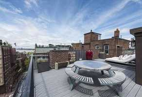 The roof deck offers city & Charles River views, water, electricity & natural gas.