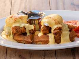 The Fried Chicken and Waffles Benedict comes with more than a day's calories at 2,580 and a four days worth of saturated fat.