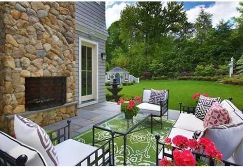 Outdoor space is an entertainer's dream complete with a huge open patio, fireplace and gorgeous private grounds!