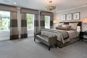 Exquisite master suite with his and her dressing rooms and two master baths.