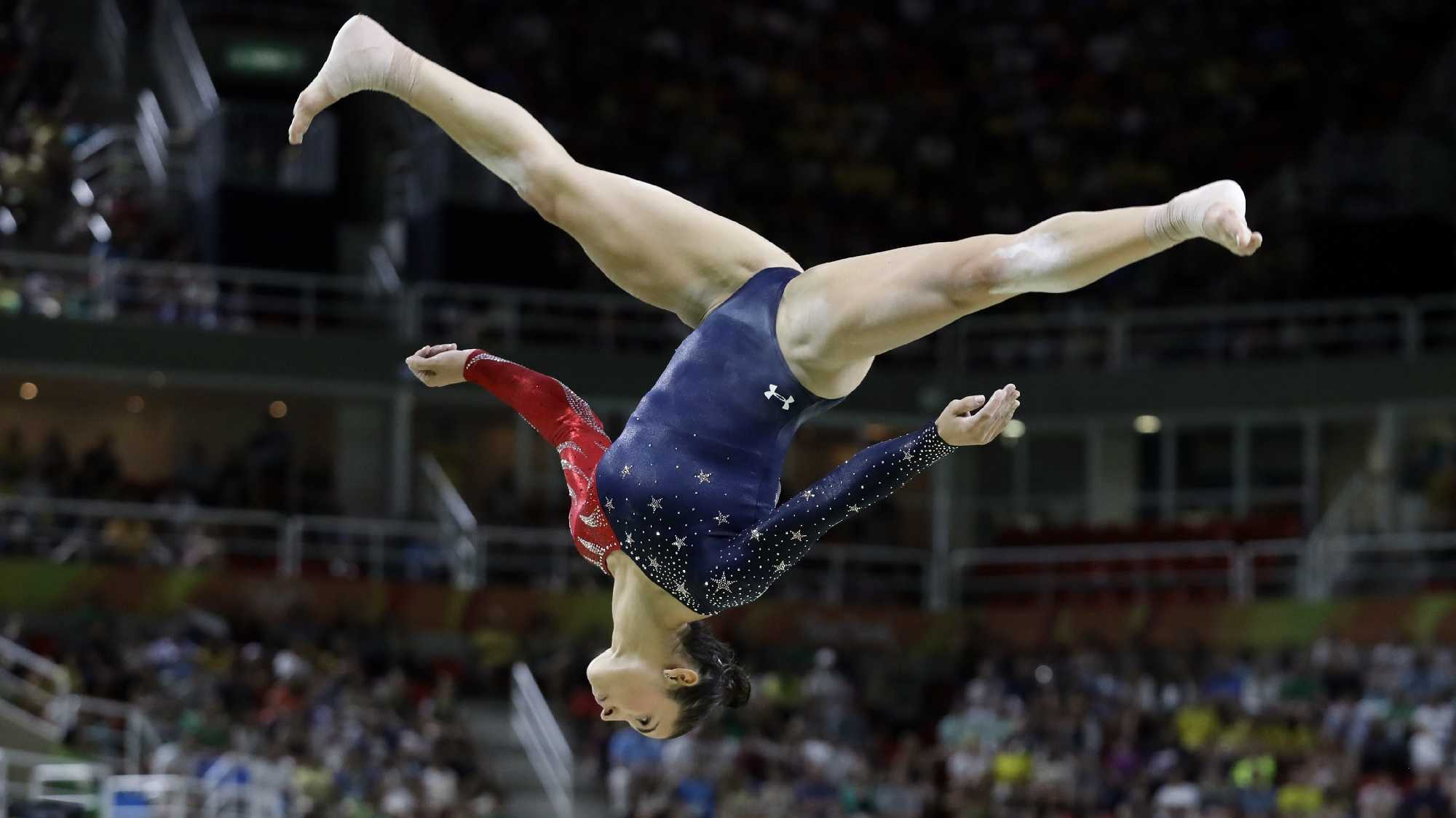 United States' Aly Raisman performs on the balance beam during the artistic gymnastics women's qualification at the 2016 Summer Olympics in Rio de Janeiro, Brazil, Sunday, Aug. 7, 2016.