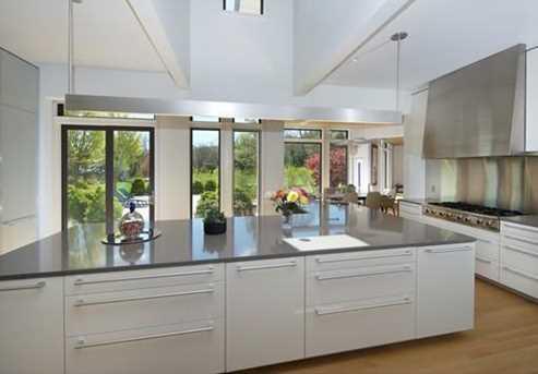 Stunning Poggenpohl kitchen w/ walk-in cold room, 2 Gaggenau ovens and microwave, Subzero refrig, 2 Miele DWs, prof 8 burner gas range.