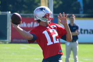 New England Patriots quarterback Tom Brady throws back to pass during the hurry-up offense.
