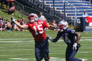 Patriots wide receiver Chris Hogan attempts to make a spectacular catch during Patriots practice Monday.