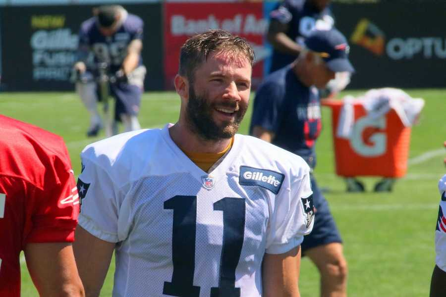 Patriots wide receiver Julian Edelman smiles for fans at Patriots practice.