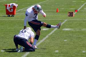 Patriots kicker Stephen Gostkowski practices field goal kicking during training camp practice Monday.