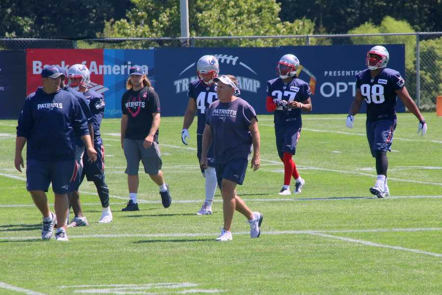 Patriots head coach Bill Belichick watches as the team finishes practice.