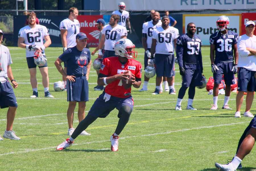 Patriots rookie quarterback Jacoby Brissett works with the team toward the end of practice Monday.
