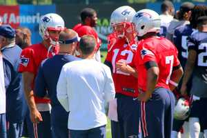 Patriots quarterbacks Jimmy Garoppolo, Tom Brady and Jacoby Brissett chat with offensive coordinator Josh McDaniels after practice.