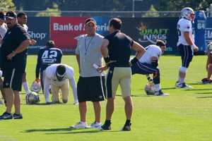 New Orleans Saints head coach Sean Payton chats with Brees before the joint practice between the Saints and Patriots.