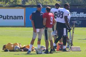 Saints quarterback Drew Brees chats with New England Patriots quarterback Tom Brady before the start of the joint training camp practice Tuesday.