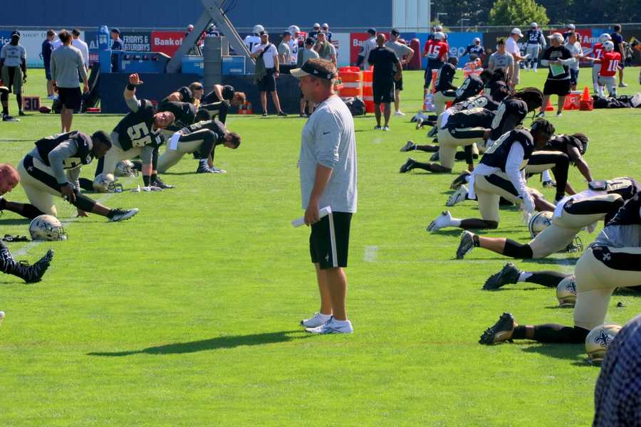 Head coach Sean Payton watches as the New Orleans Saints warm-up on the practice field fans were used to watching the New England Patriots on.