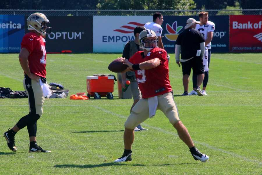 Saints quarterback Drew Brees throws a pass during one-on-one drills.