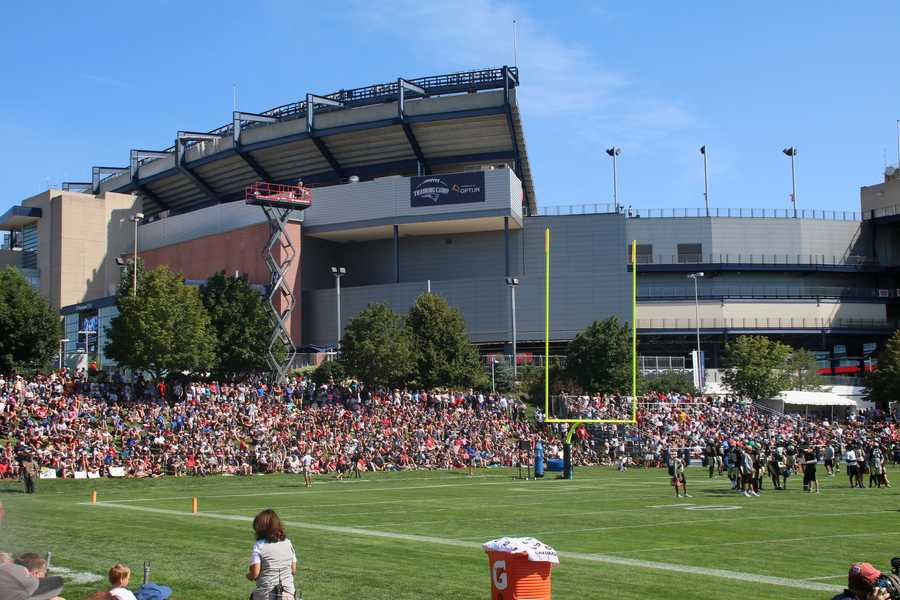 A larger than normal crowd packed the training camp facility at Gillette Stadium Tuesday morning as the Patriots hosted the New Orleans Saints.