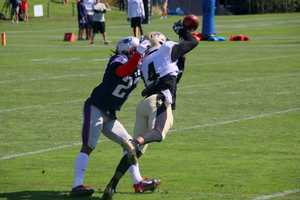 One-on-one drills between the Saints receivers and Patriots defenders.