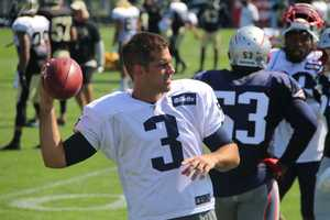 Patriots kicker Stephen Gostkowski tossing the football to wide receiver Danny Amendola, who was on the PUP list.