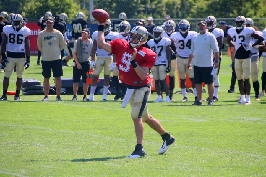 Drew Brees throws a pass during a scrimmage between the two teams.