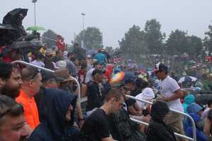 You could call these the die-hard Patriots fans. They stuck around in heavy rain to watch the Patriots and Saints practice in Foxborough.