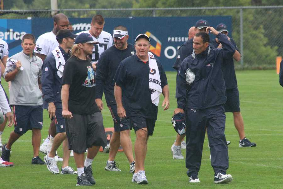 Patriots head coach Bill Belichick walks toward the center of the field at the end of practice.