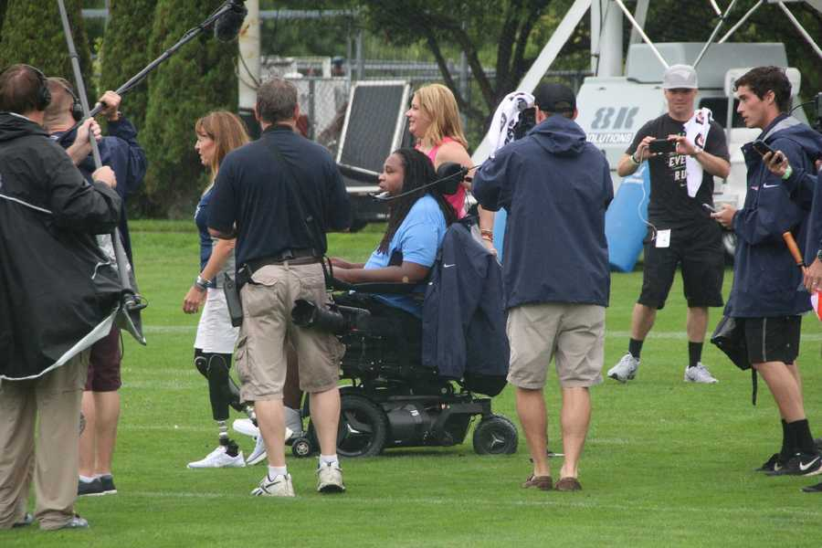 Eric LeGrand, a former college football player from Rutgers, who became paralyzed while making a tackle, meets with both the Patriots and Saints after practice.
