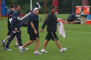 Patriots head coach Bill Belichick and Saints head coach Sean Payton head over to speak to LeGrand.