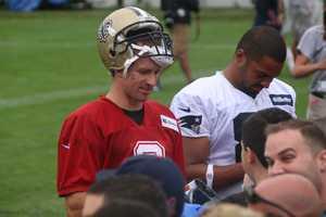 Saints quarterback Drew Brees signs autographs following practice.