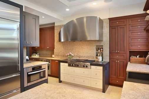 Chef's kitchen with a gorgeous custom cabinetry& fossil granite counters, built-in seating area, Wolf/Viking/SubZero, Miele/Asko appliances.