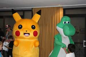 Pikachu and Yoshi smiling for the camera.