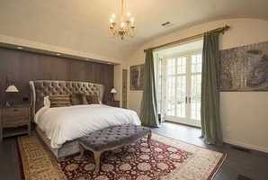 Master suite was just renovated adding a fireplace, French doors and marble bath.