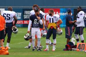 Patriots wide receiver Julian Edelman chats with Bears wide receiver Daniel Braverman before the start of practice Tuesday.