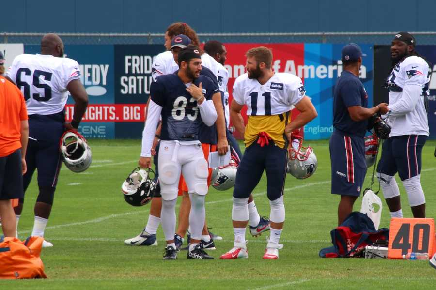 Patriots wide receiver Julian Edelman chats with Bears wide receiver DanielBraverman before the start of practice Tuesday.