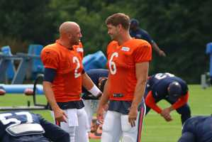 Former New England Patriots quarterback Brian Hoyer chats with Bears quarterback Jay Cutler during practice at Gillette Stadium in Foxborough.