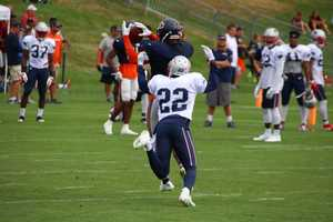 A Bears wide receiver makes a catch against Patriots defensive back Justin Coleman during one-on-one drills.