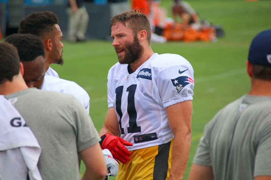 Patriots wide receiver Julian Edelman chats with teammates on the sidelines during practice with the Chicago Bears.