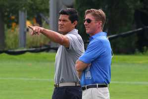 Former Patriots star Tedy Bruschi watches the action at Tuesday's joint practice between the Patriots and Bears.