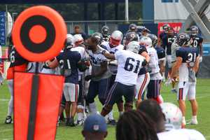 Patriots tight end Martellus Bennett can be seen reacting during a scuffle between the Bears and Patriots.  Offensive lineman Bryan Stork was ejected from practice, ESPN reported.