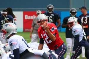 Patriots quarterback Tom Brady moving the offense around before a play against the Bears.