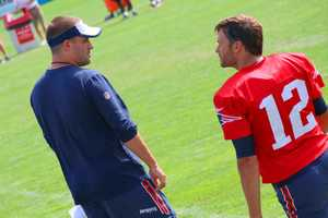 Tom Brady seems like he's always talking with one of the coaches or players. Here, he chats with offensive coordinator Josh McDaniels.